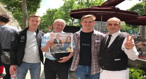 L-R, Jacob Dearth, Steve Roberts holding MLiving, and Liam Glover with  George V restaurant waiter on the Champs Elysee