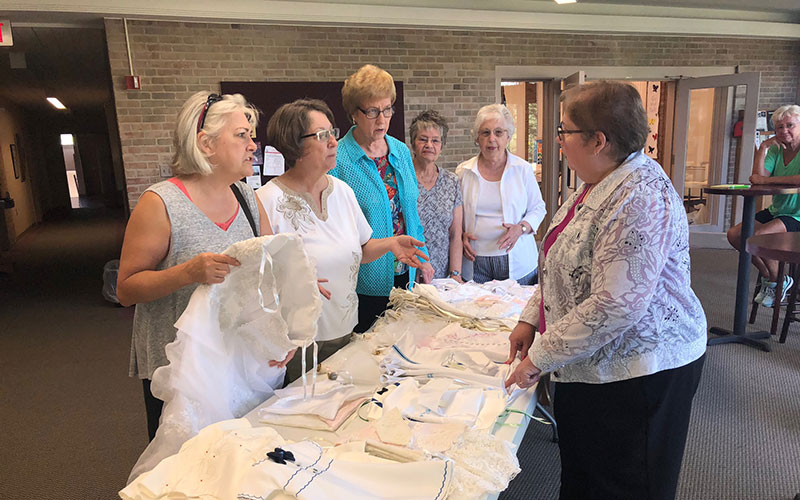 Volunteers from Sylvania United Church of Christ meet regularly to transform donated wedding dresses into burial gowns for infants.