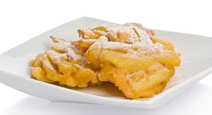 One of Wolfgang Puck's favorite ways to prepare autumn apples is to cut them up into matchstick shapes and turn them into fritters. Photo Credit: Dreamstime.com