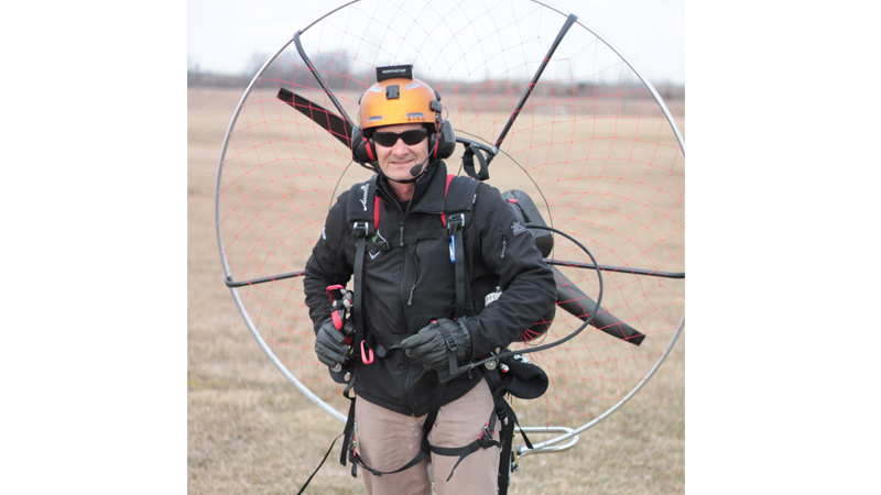 Doug Helminiak suits up for a parglide at Timberstone Junior High School, a favorite spot for the Toledo Fly Boys.
