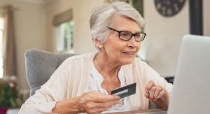 old-woman-paying-bills-online