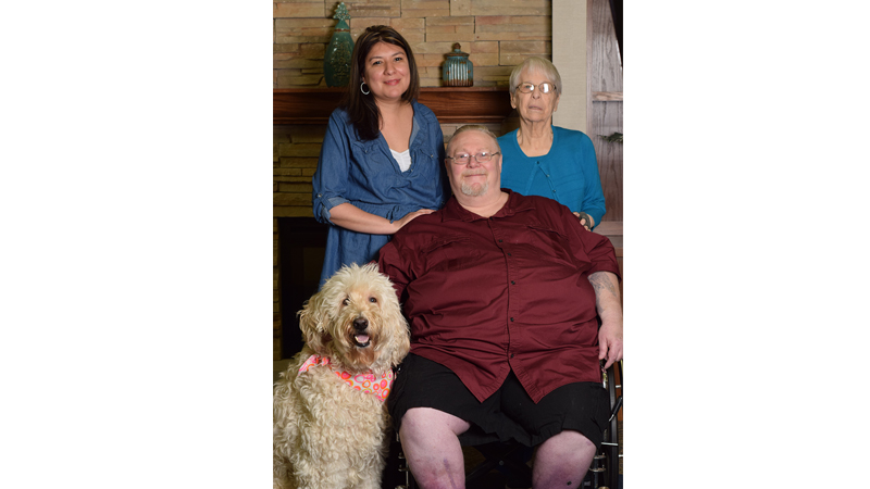 Maria (Rec Therapy Director), Frankie (therapy dog), Bill Booth and Donna Achter.